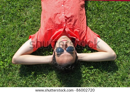 Man takes a rest in the grass