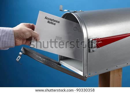 Man takes Acceptance Notice out of an open mailbox