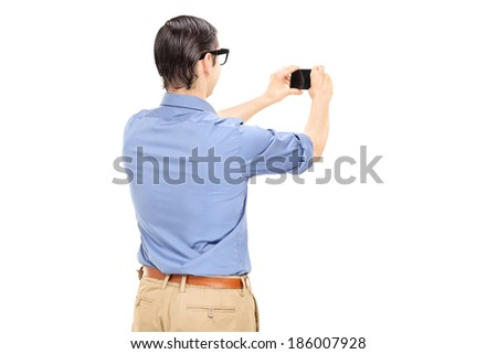 Man taking a picture with cell phone isolated on white background