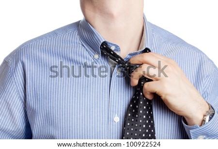 Man taking off neck tie
