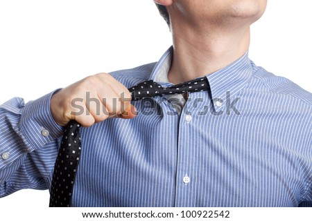 Man taking off neck tie