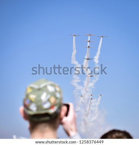 Man taking Photos of the Harvard( ex-air force trainers) 80th anniversary fly over at the Rand airshow in Johannesburg South Africa