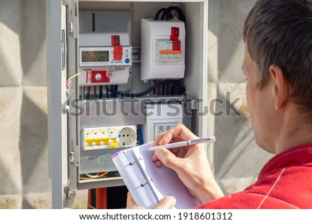 Man taking readings of an electric meter Photo stock ©