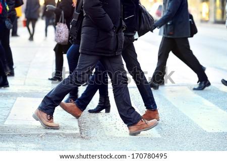 Man taking the step (onto zebra crossing)