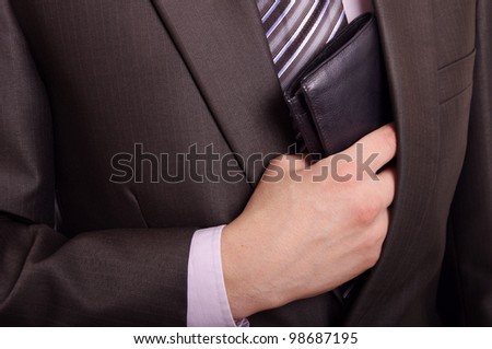 man taking wallet