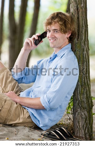 Man talking on cell phone outdoors