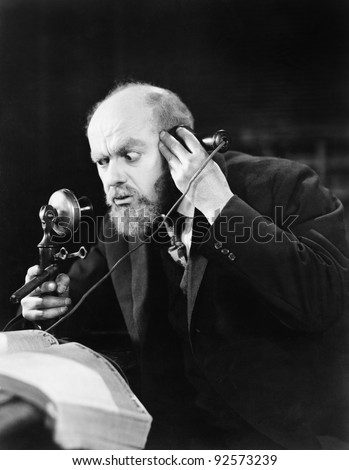 Man talking on the telephone looking intense