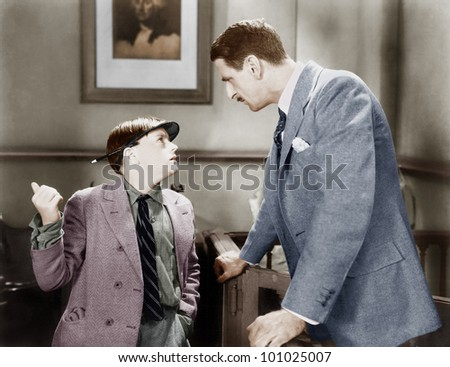 Man talking to a young boy reporter