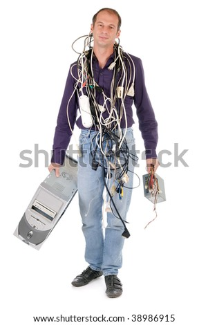 man tangled with cables having problem with his computer - stock photo