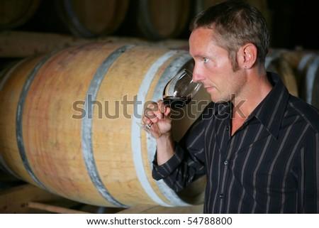 Man tasting a glass of wine
