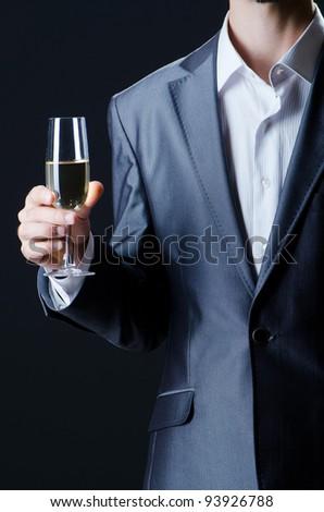 Man tasting wine in glass