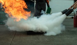 Man teaches or training how to use carbon dioxide  (CO2) fire extinguishers to extinguish fires from fuel.