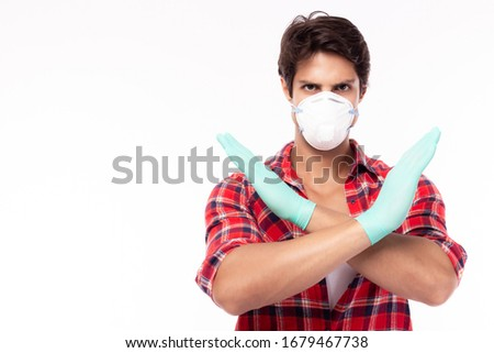 Man tell people please stop spreading viruses, flu, covid19, coronavirus to people. Young guy wear face mask, medical glove. He doesn't want air pollution or infection of viruses, flu, corona virus