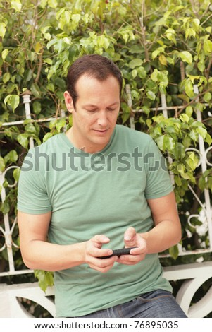Man texting on his smartphone
