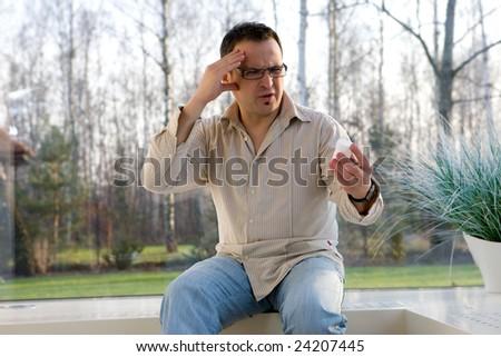 Man that has an intense headache.