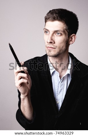 Man thinking about a solution with a pencil