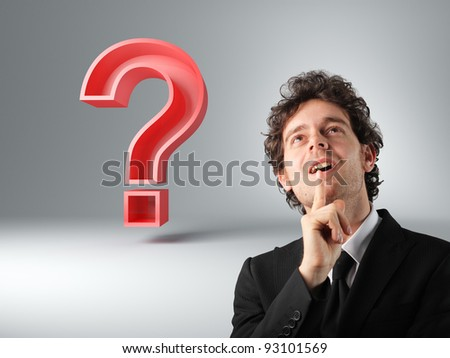 man thinking and 3d big red question mark