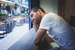 Man thinking by the bar window