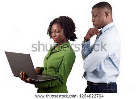 Man thinking thinking looking into the laptop. Managers meeting. Idea, analysis marketing plans. Workplace concept, start up project with a female colleague