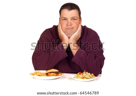 man thinking what to eat between an cheeseburger and a salad (isolated on white)
