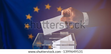 Man throwing his vote into the ballot box. EU elections. Elections to the European Parliament