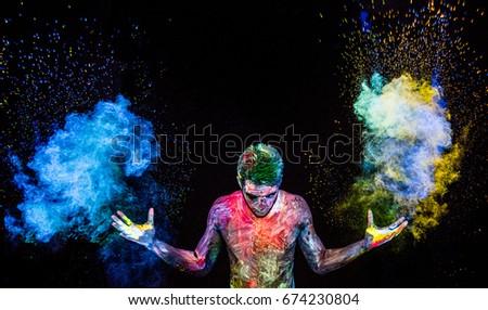 Man throwing up glowing powder