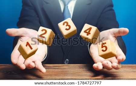 Man throws 5 numbered blocks with the numbers one two three four five from his hands. Five easy steps. Organization and systematization, step by instructions. Business planning, action plan. Stock photo ©