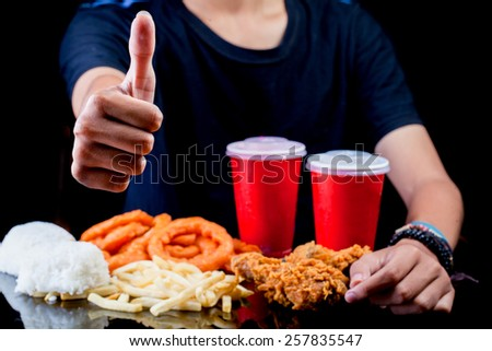 Man thumbs up in front of junk fast food package