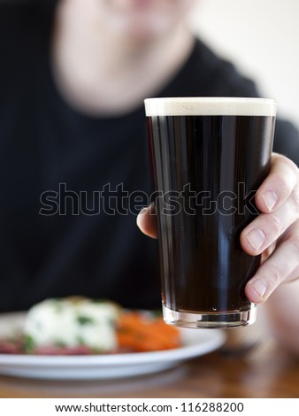 Man toasting with a beer