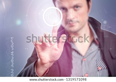 man touches a touch screen