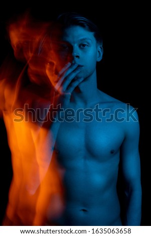 man touches lips shuts his mouth.  naked torso. Long exposure. Ghost. abstract conceptual artistic view. representation of subconscious feelings and thoughts. don't speak keep silence