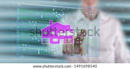 Man touching a digital smart home automation concept on a touch screen with his finger