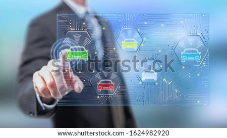 Man touching a smart car concept on a touch screen with his fingers
