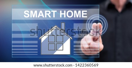 Man touching a smart home concept on a touch screen with his fingers #1422360569