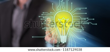Man touching a technology innovation concept on a touch screen with his finger
