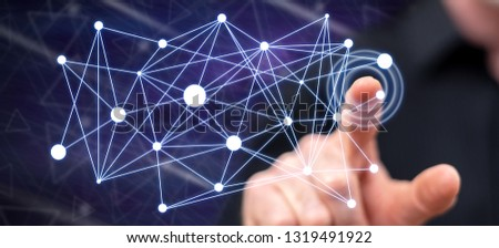 Man touching a virtual network on a touch screen with his finger #1319491922