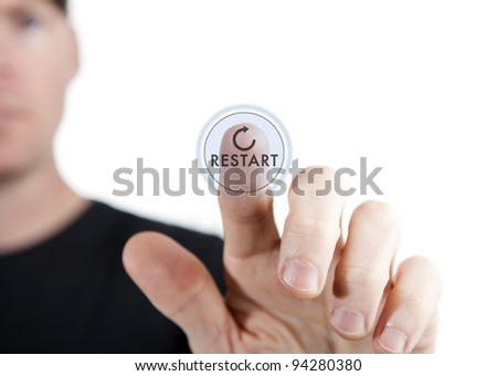man touching a virtual restart button