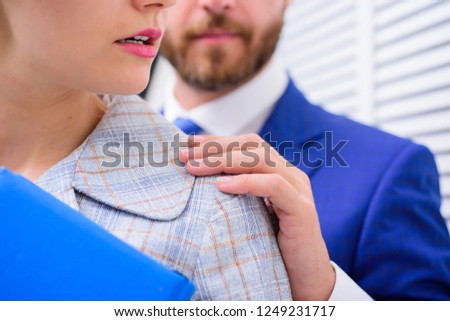 Man touching girl. Protection female rights. Sexual harassment at work