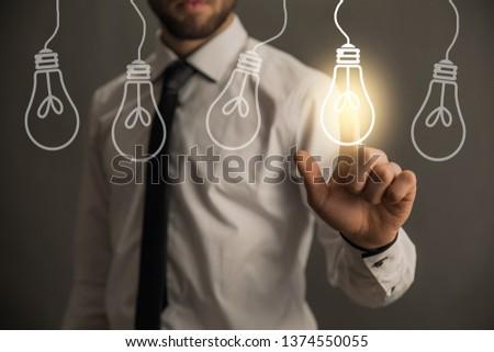man touching in light bulb in screen #1374550055