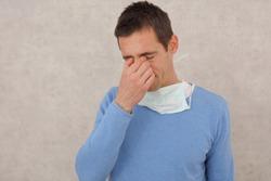 Man touching is face, eyes. Coronavirus prevention, New habits, Self-isolation , Quarantine
