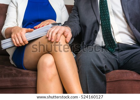Man touching woman's knee - sexual harassment in business office #524160127