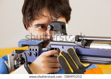 Man training sport shooting with air rifle gun
