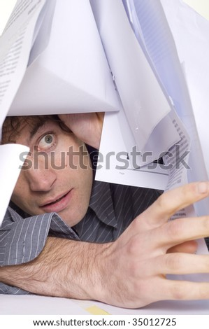 Man trapped under pile of paper work