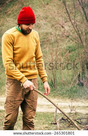 Man Traveler alone in forest survival concept Lifestyle nature on background