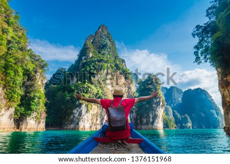 Man traveler on boat joy fun with nature rock mountain island scenic landscape Khao Sok National park, Famous travel adventure place Thailand, Tourism beautiful destinations Asia holiday vacation trip