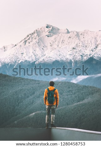Man traveler standing alone enjoying mountains view active adventure lifestyle vacations travel outdoor solitude and silence #1280458753