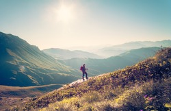 Man Traveler with backpack hiking Travel Lifestyle concept beautiful mountains landscape on background Summer vacations activity outdoor