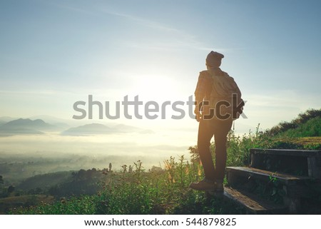 Shutterstock Man Traveler with backpack mountaineering Travel Lifestyle concept