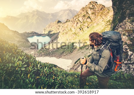 Man Traveler with backpack mountaineering Travel Lifestyle concept lake and mountains landscape on background Summer vacations adventure outdoor  #392618917