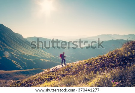 Man Traveler with backpack trekking Travel Lifestyle concept mountains on background Summer vacations activity outdoor aerial view